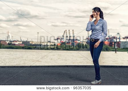 Woman Wearing Skinny Jeans While Talking On Phone