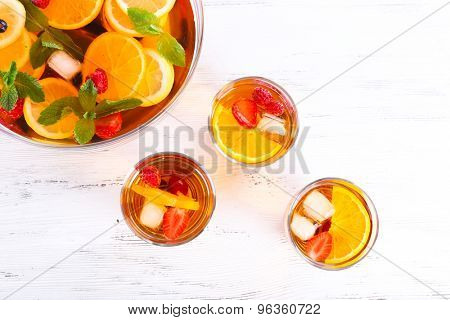 Fruity punch in glassware on wooden table, top view