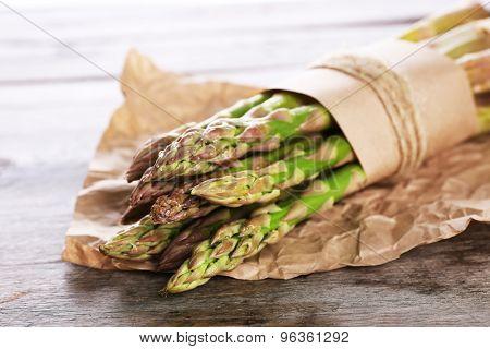 Fresh asparagus on wooden table, closeup