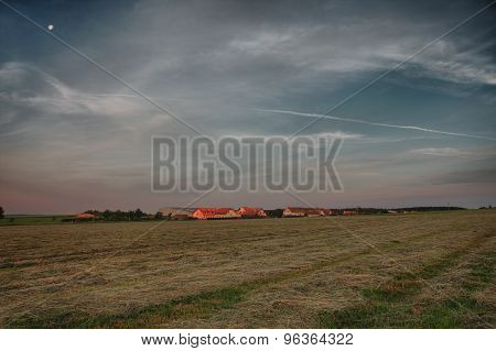 Sunrise Time In Summer Morning , Meadow With Cut Grass,village  And Colour Sky
