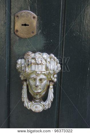Rusty Door Knocker On Aged Door