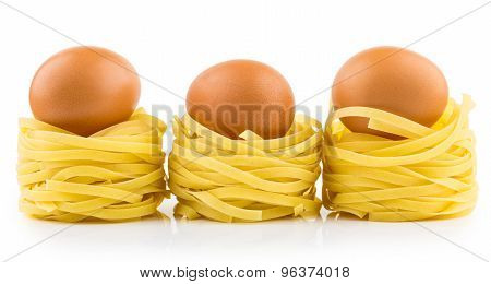 Row From Pasta In Form Nest And Egg With Reflection