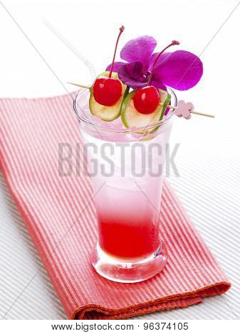 Thai Red Cocktail with orchid, lime and cherry
