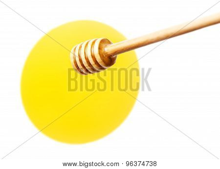 Honey Dripping From Wooden Honey Dipper Isolated  On White Background Macro.