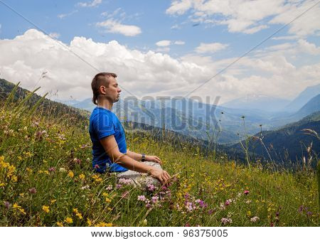 Man meditating in mountains