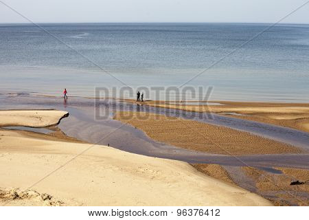 Smal river mouth flows in calm sea