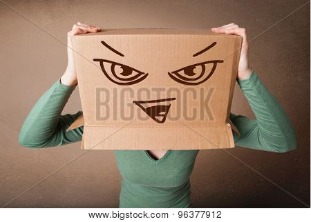 Young woman standing and gesturing with a cardboard box on her head with evil face