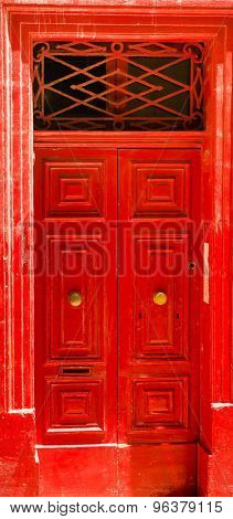 colorful red front door to house