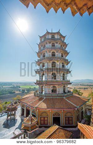 Tall Chinese Pagoda in Wat Tham Khao Noi temple, Kanchanaburi, Thailand