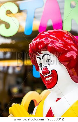 KRABI, THAILAND - July 18, 2015: View of Ronald McDonald in front of a McDonald's  on July 18, 2015 in Krabi, Thailand. McDonald's operates in 119 countries with 160 stores in Thailand.