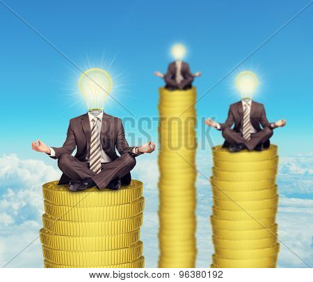 Sitting businessmen on coins steps