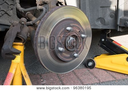Worn Car Brake Disk  Brake Caliper Removed