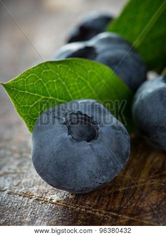 Blueberries on wooden table, close-up.