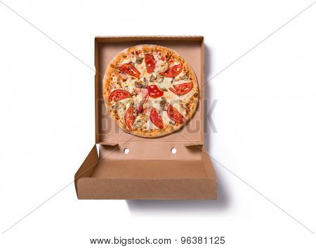 Fresh tasty Italian pizza with ham and tomatoes in delivery box, isolated on white background