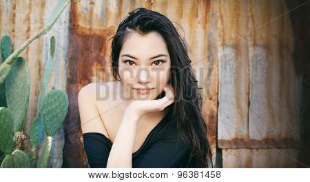Beautiful face with slight smile young Asian woman