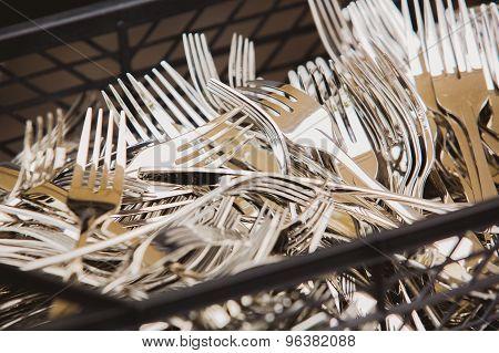 Closeup of shiny spoon, knife, fork
