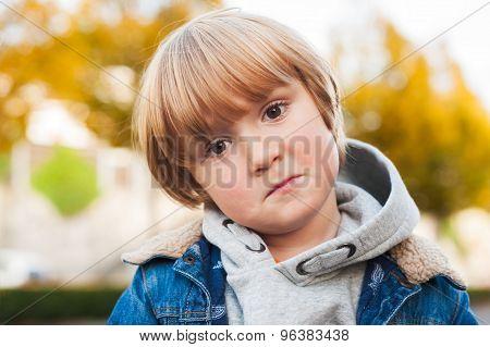 Close up portrait of a sad toddler boy