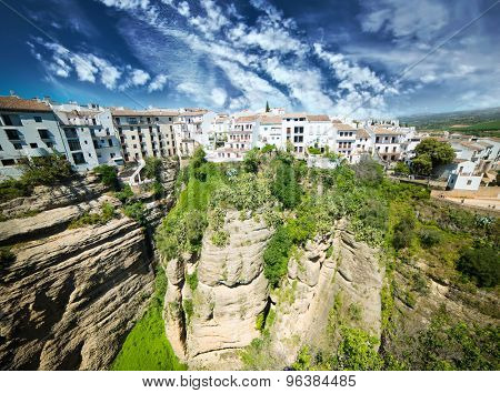 Panoramic view from New bridge in Ronda against sky in Andalucia, Spain