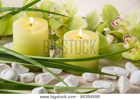 Spa still life with candles,pebble stones and orchid