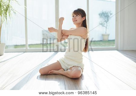 Asian woman stretching in the room