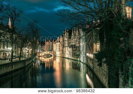 Night tower Belfort and the Green canal in Bruges