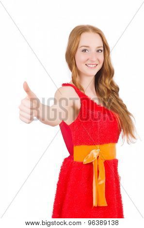 Young beautiful girl in red dress thunms up isolated on white