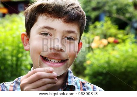 Teenager Boy Smile With Magnifying Glass
