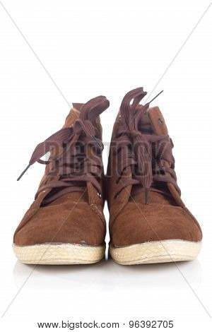 Pair Of Old Brown Working Boots With Shadows
