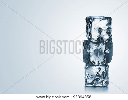 Stack Of Three Blue Ice Cubes With Copyspace