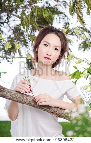 Beautiful woman in flower garden