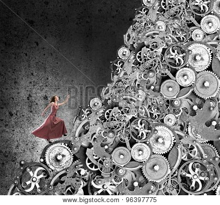 Young woman in evening dress climbing gears