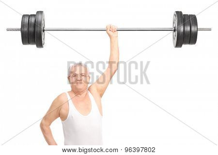 Semi-dressed senior lifting a heavy barbell with one hand and looking at the camera isolated on white background