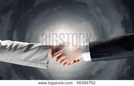 Close up of businessman hands making deal