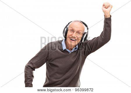 Overjoyed senior listening to music on headphones isolated on white background