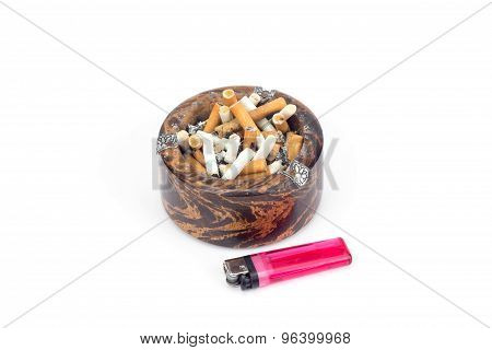 Butt Cigarettes In Wooden Ashtray And Lighter