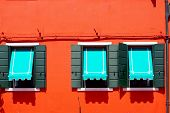 image of canopy  - three Windows with blue canopy in Burano on red orange wall building architecture Venice Italy - JPG