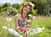 stock photo of hippy  - Portrait of hippie girl in a wreath of wild flowers - JPG