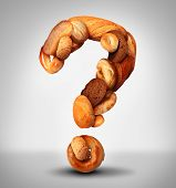 foto of whole-grain  - Bread questions food concept with a group of baked goods from a bakery or home cooking shaped as a question mark made from whole wheat and grains with breads as pumpernickel pita focaccia and bagel - JPG