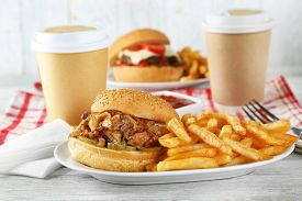 stock photo of burger  - Tasty burger and french fries on plate - JPG