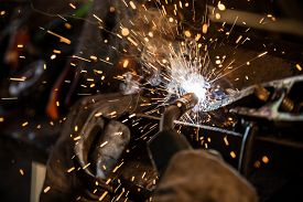 pic of sparking  - Welder in action with bright sparks - JPG