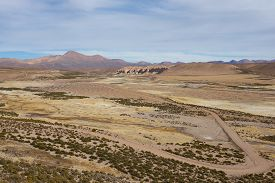 image of open grazing area  - Large open plain created by the River Lauca in Lauca National Park - JPG