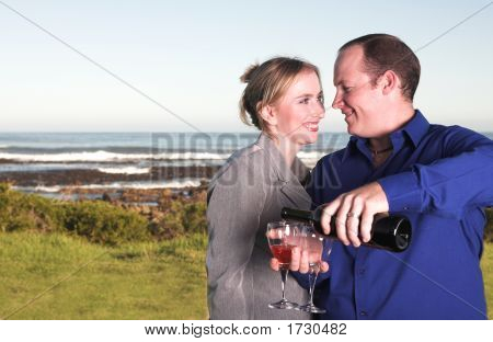 Couple Next To The Coast Drinking Wine