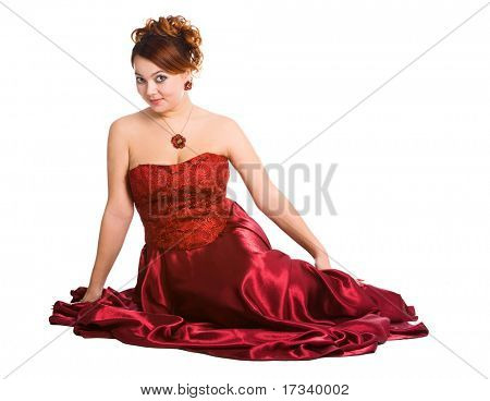 young attractive woman sitting in long red dress.