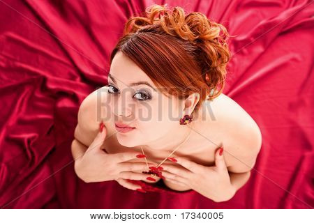 young attractive woman in long red dress. view from above.