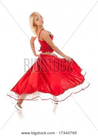 young dancing woman in long red dress
