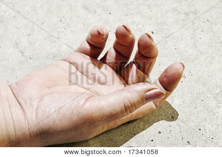 woman hand lying on road surface