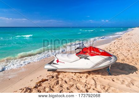 PLAYA DEL CARMEN, MEXICO - JULY 16, 2011: Lifeguard jet ski on the beach of Playacar at Caribbean Sea of Mexico. This resort area is popular destination with the most beautiful beaches.