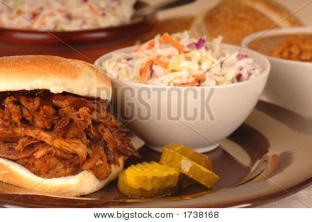 Pulled Pork Sandwich With Cole Slaw And Beans