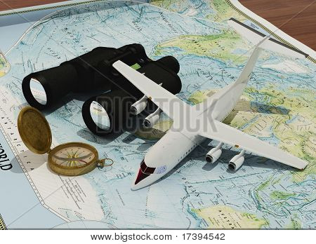 Binoculars, compass and a model airplane on the map.
