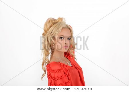 Young blonde teenager girl in studio